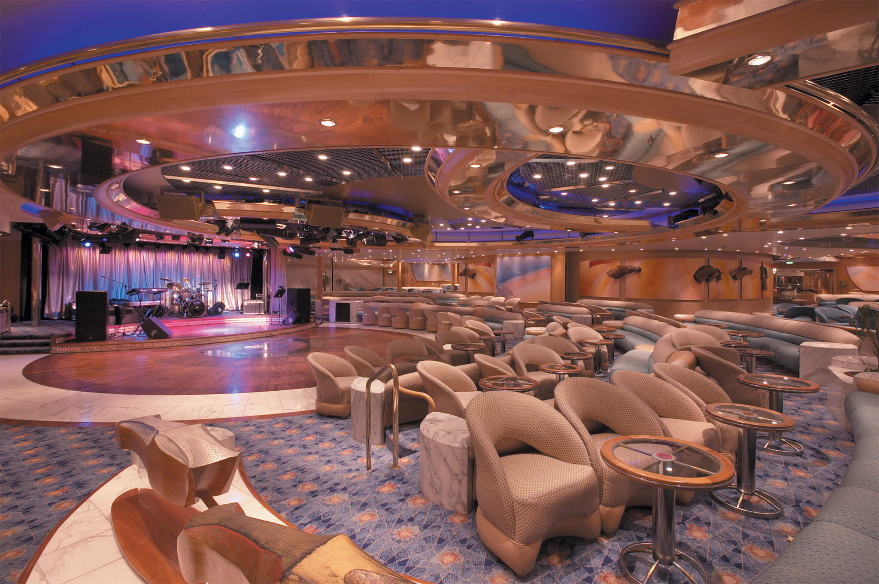 Круизный лайнер Enchantment of the Seas - Гостиная Carousel (Carousel Lounge)